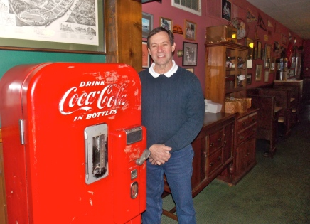 Bob Berg, owner of Sid's, with one of the restaurant's many antiques